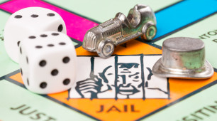 Monopoly Board With The Dice And The Car And The Hat
