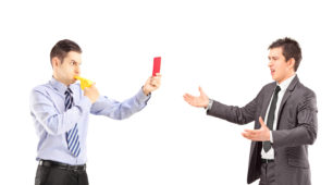 Employee Blowing A Whistle And Giving Another Employee A Red Card